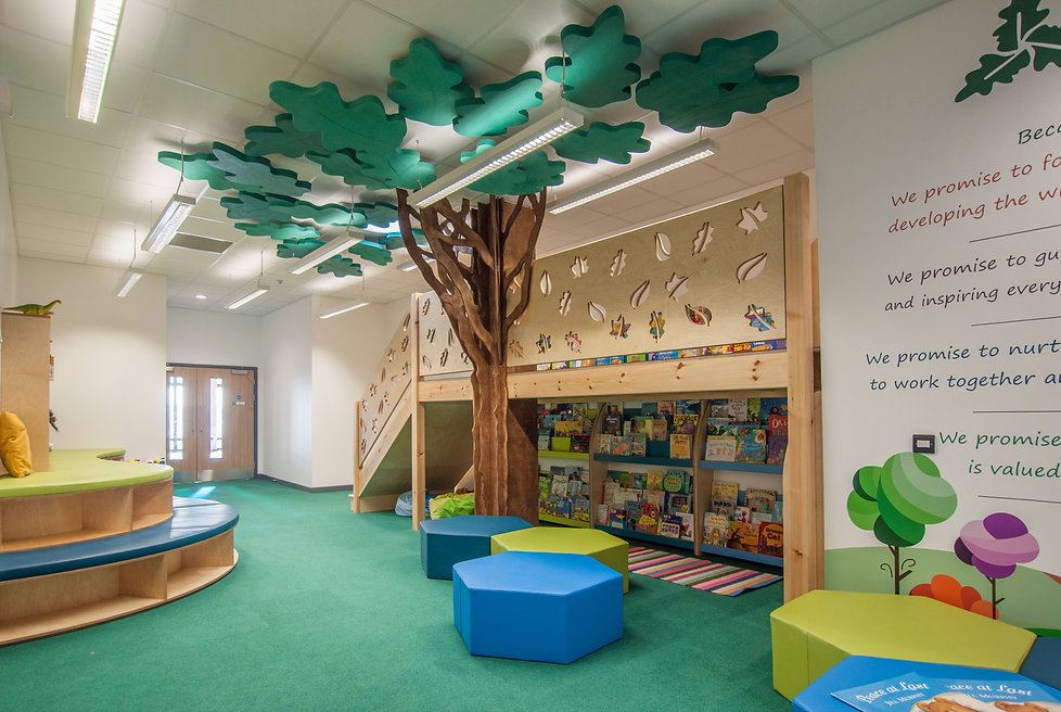 Primary School library with feature oak tree and mezzanine level