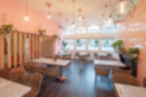 restaurant area with pink tiles and timber screen