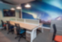 mural feature wall of northern lights with office furniture