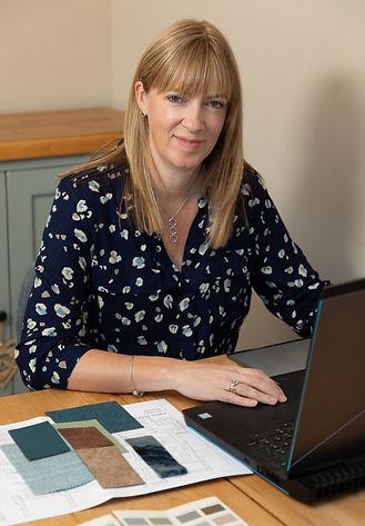 Sarah Cox at desk