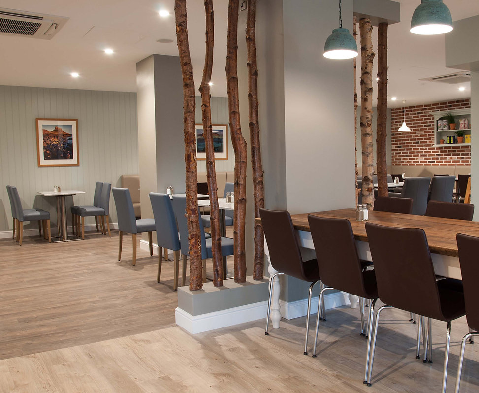 Barkers Kitchen seating area with silver birch tree screens