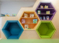 brightly coloured honeycomb seating pods and shelves