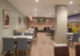 Barkers Kitchen with feature mural and brick wall