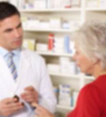 American pharmacist with senior woman in
