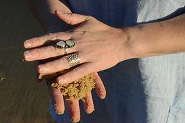 Hands in the sand Luminous Design Store.