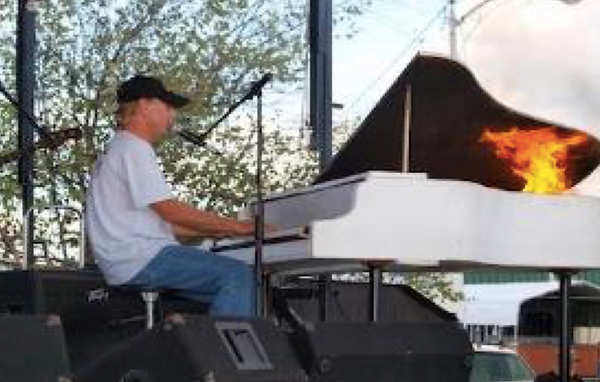 JR setting piano on fire during performance