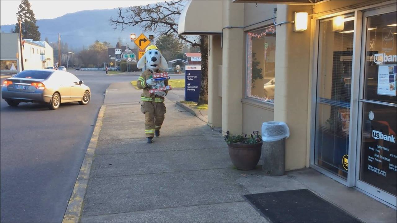 Sparky delivers presents to local Tree of Joy