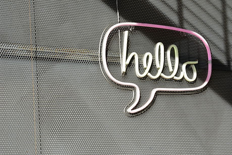 neon sign that says Hello