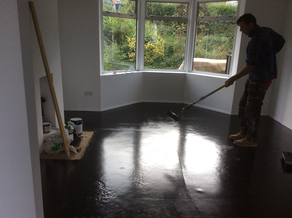 Painting floors with black floor paint  Muswell Hill, London, N10