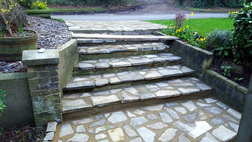 Yorkstone crazy paving steps leading to street level, Mill Hill, London NW7