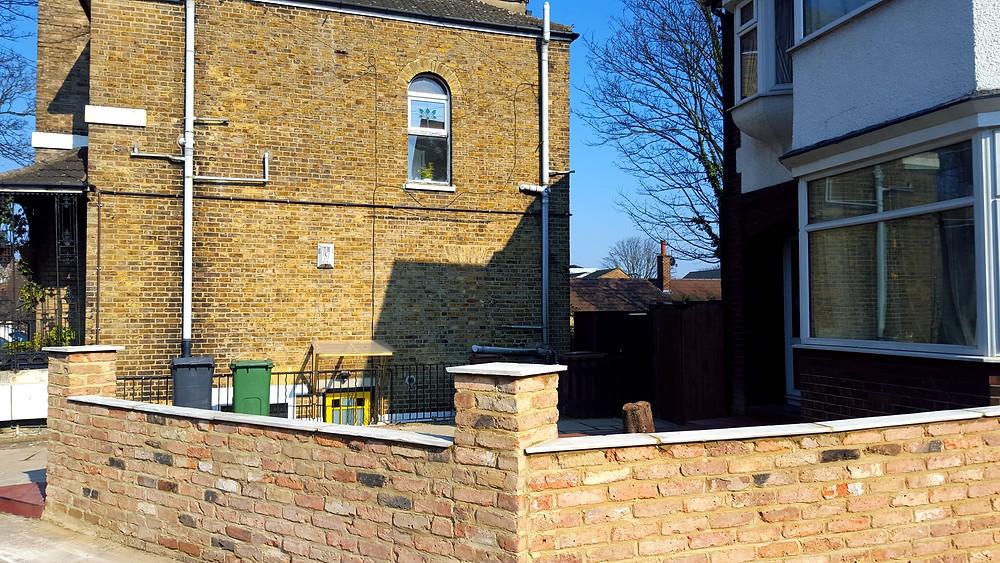 New garden wall with reclaimed mixed stock bricks, Walthamstow, E17
