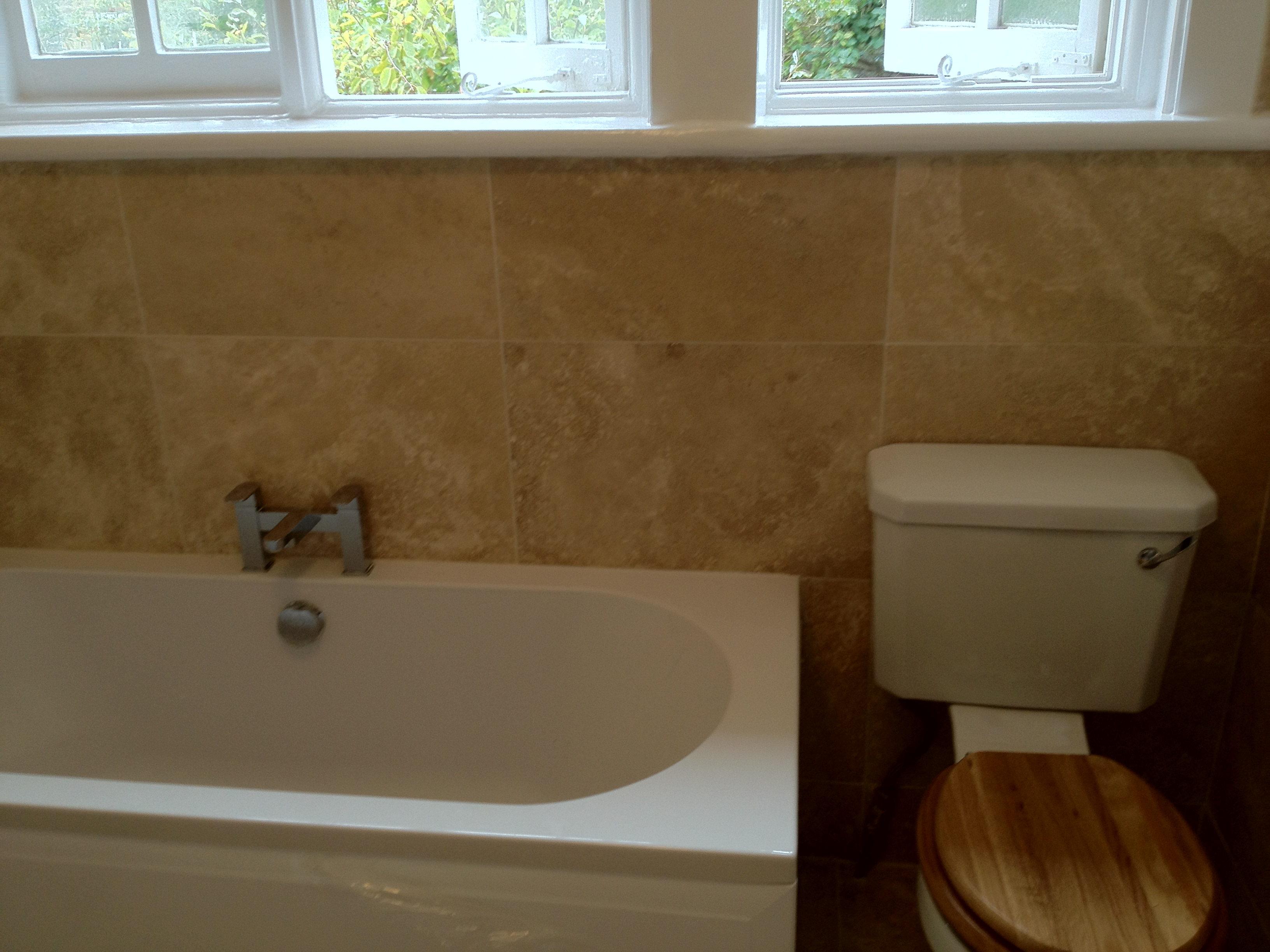 Installing new bath, North London