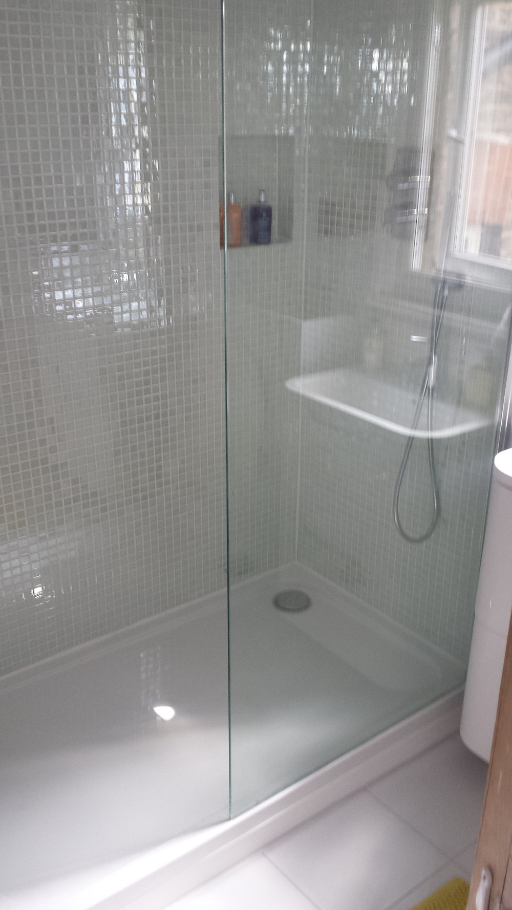 Mosaic tiling shower enclosure