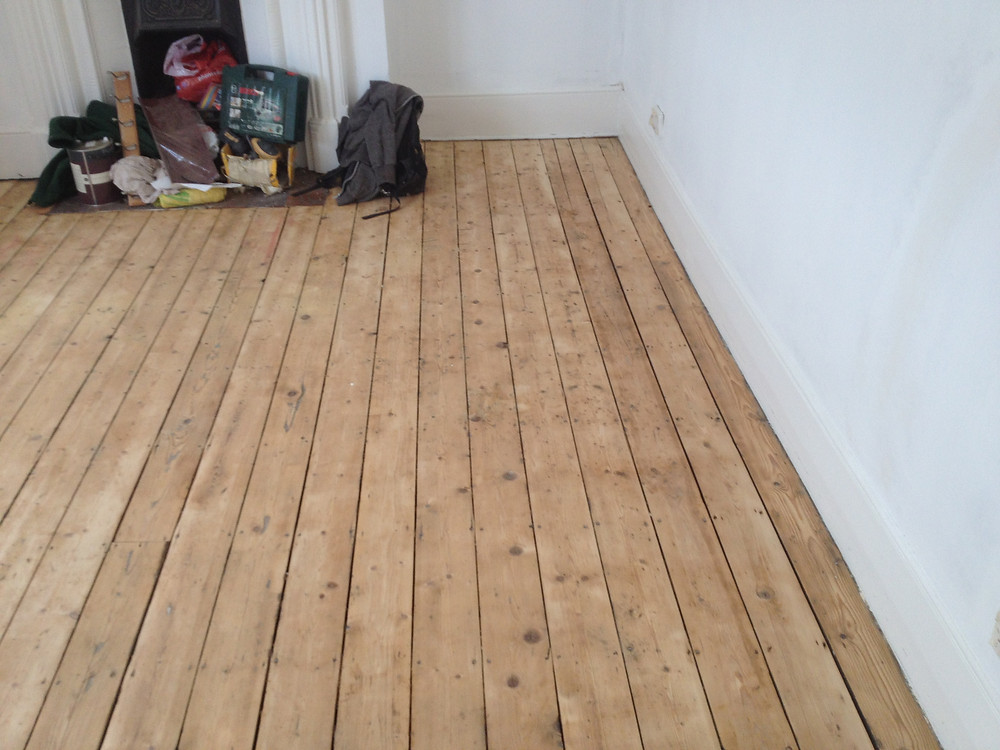 Floor boards sanded down and repaired