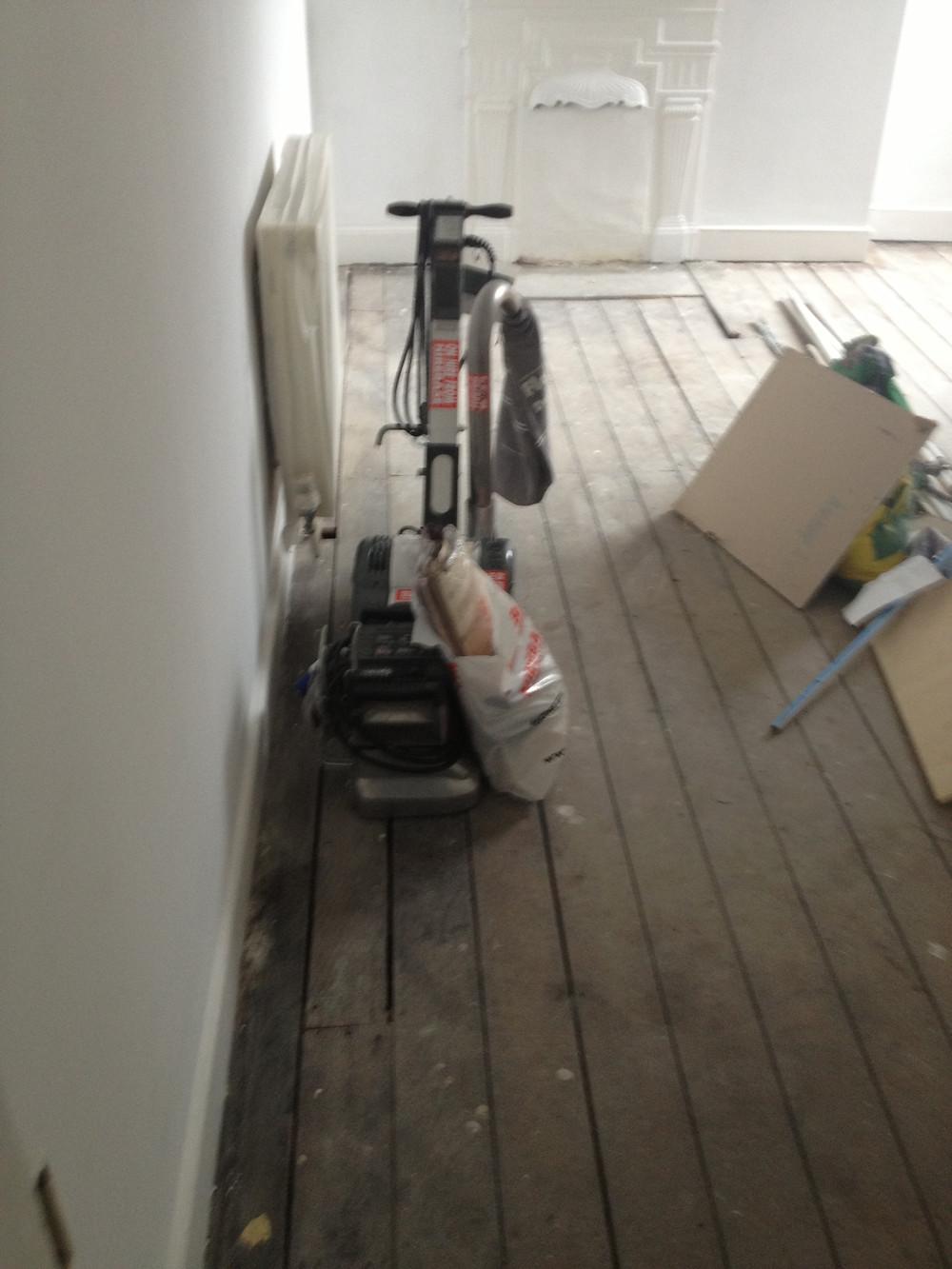 Floor boards before repair work