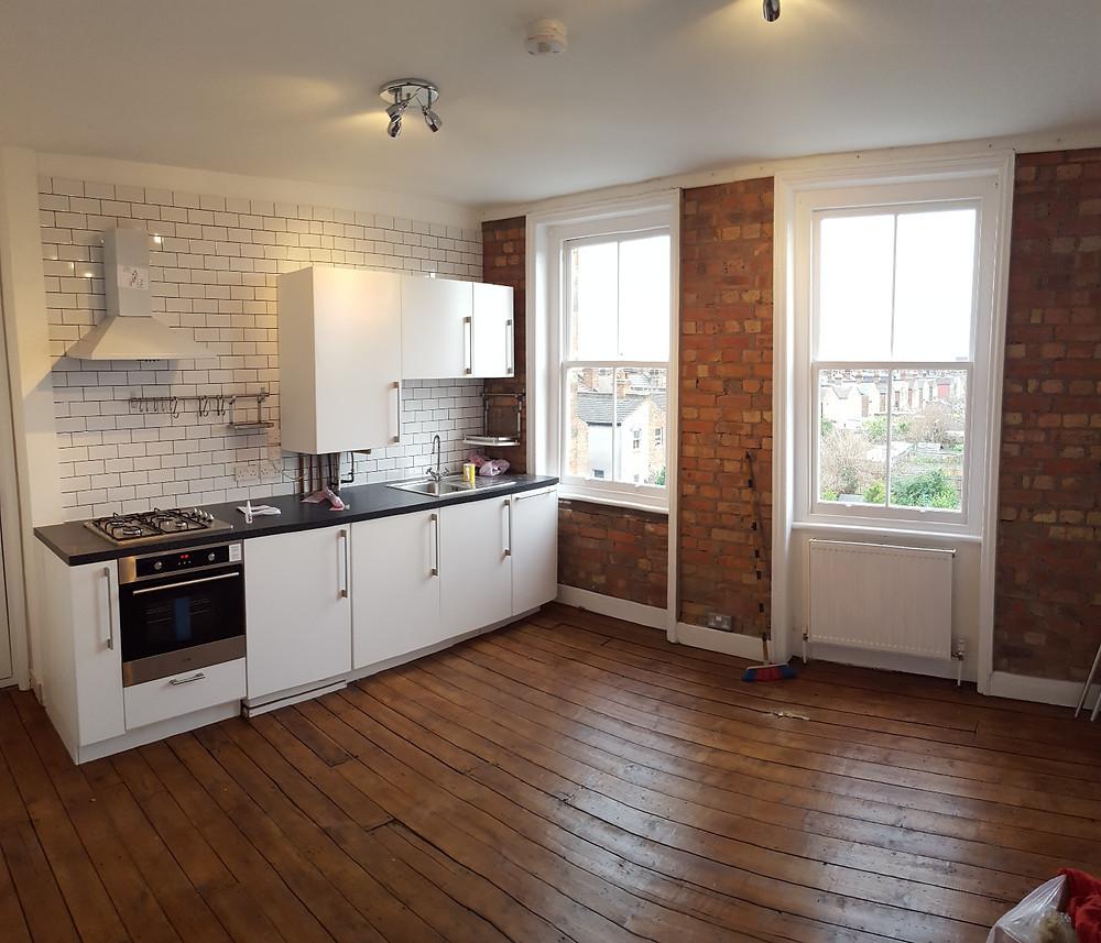 Kitchen exposed brick wall, plastering painting and floor varnish Haringey, London, N4
