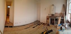 Repairing floor boards in kitchen