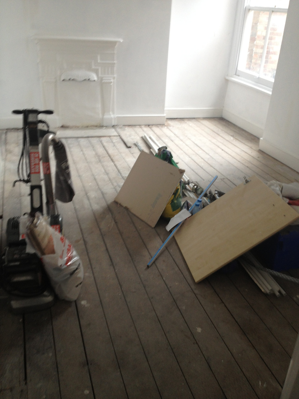 Floor boards and industrial sander at start of work