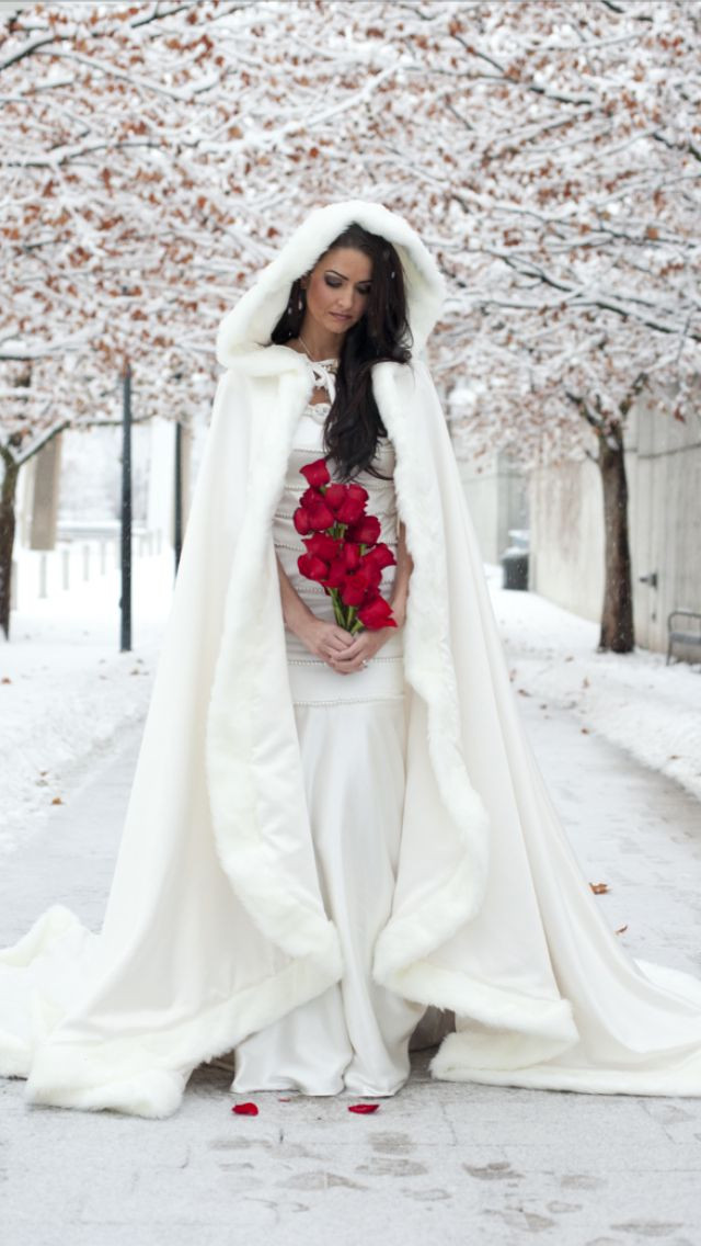 winter bride with a cape