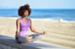 black-woman-afro-hairstyle-doing-yoga-in