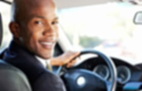 young-black-man-driving-looking-back-102
