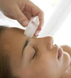 quartz crysal on womans 3rd eye