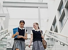 Grammar school girl pupils on the stairs.