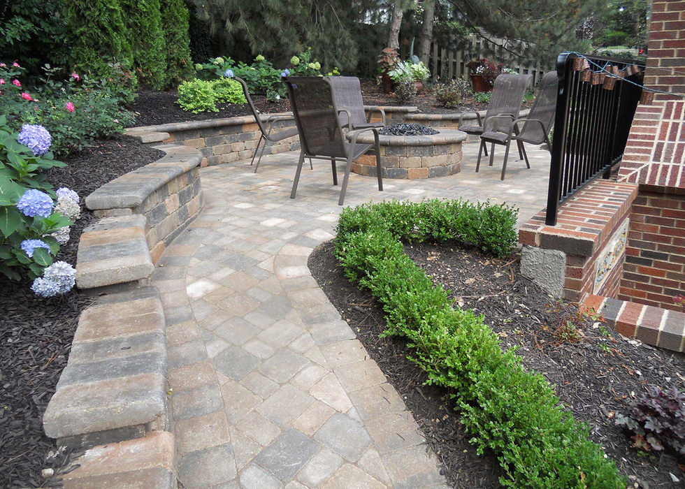 Outdoor living space with gas fire pit.