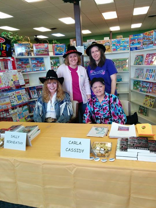 Our MRW crew enjoying time with readers at a local book signing