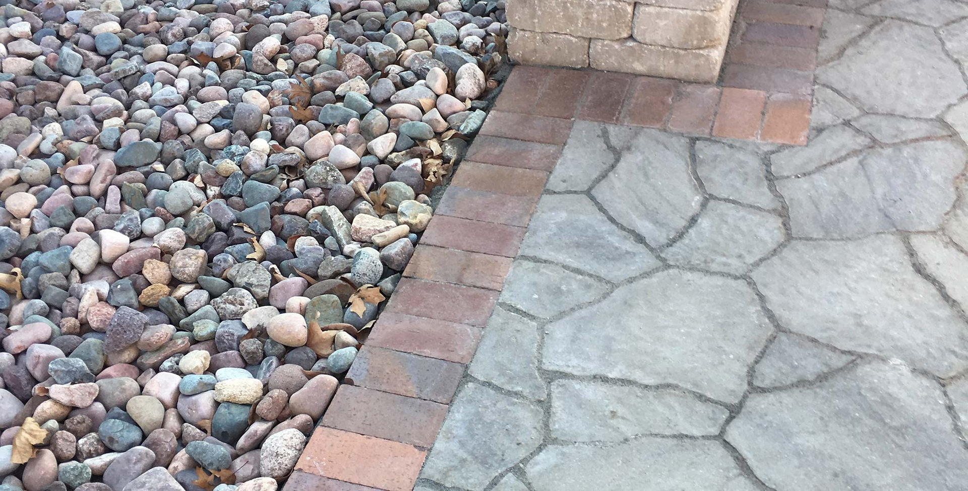 Belgard pavers with river rock.