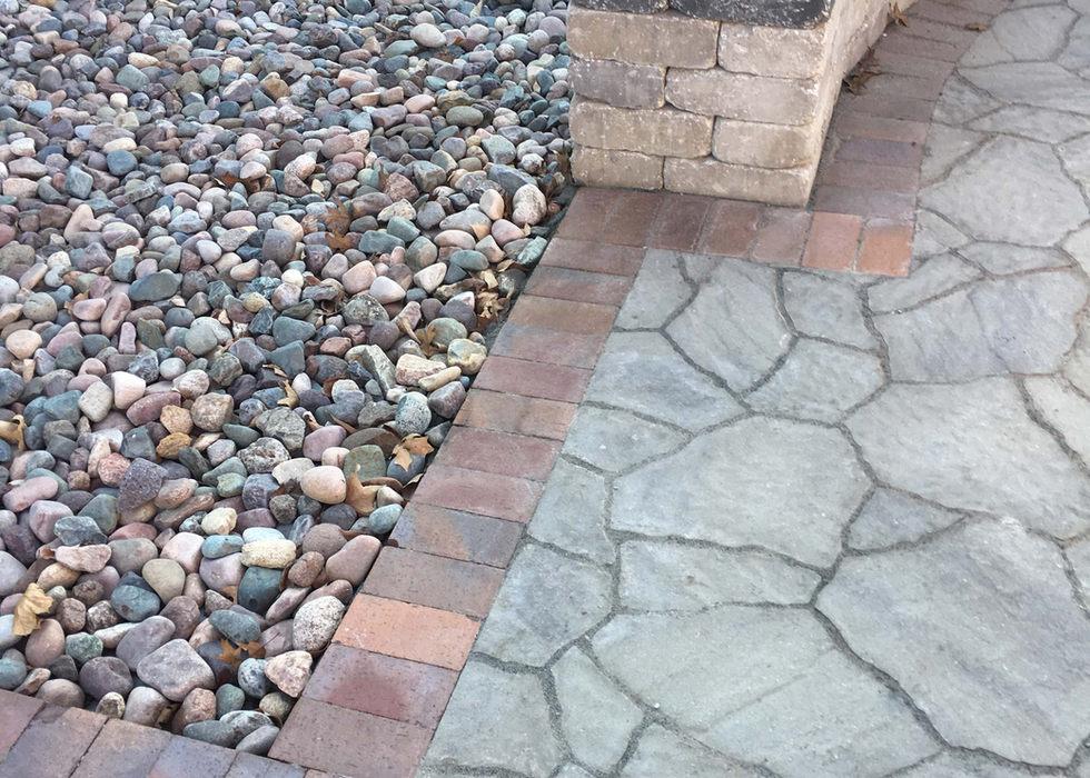 Belgard pavers with river rock.