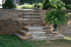 Integrated retaining wall steps to elevated patio.