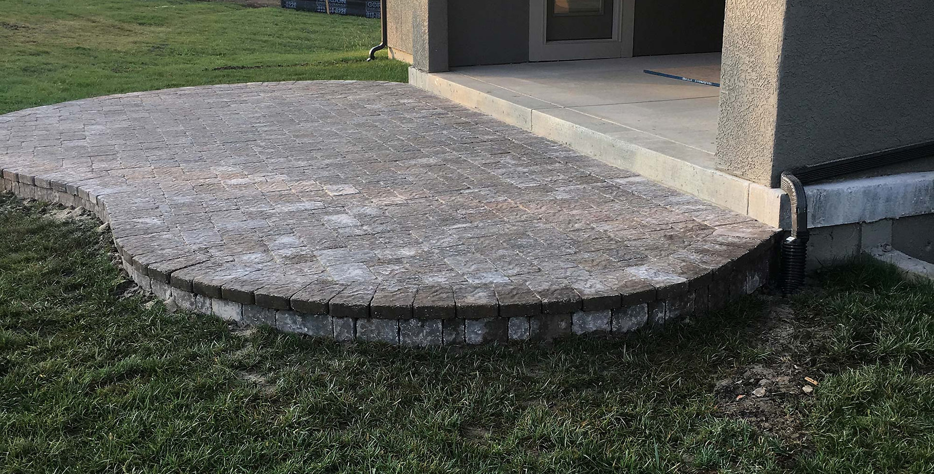 Raised Bergerac paver patio in South Overland Park.