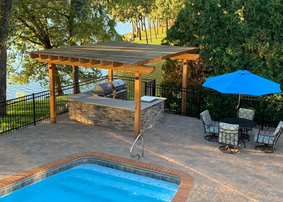 Pool pavers and outdoor kitchen.