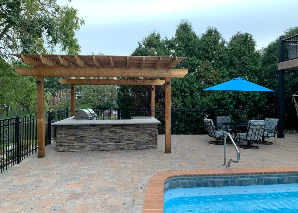 Pool deck in Venetian pavers.