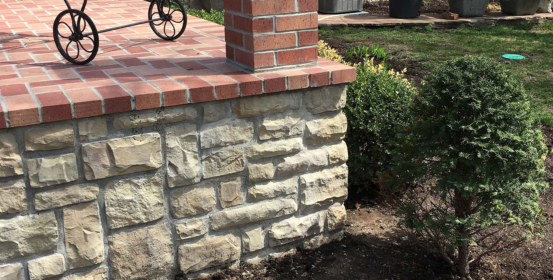 Endocott mortar set brick patio.
