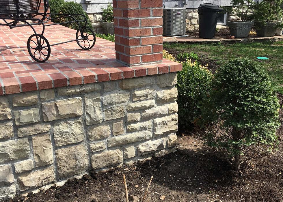 Endocott mortar set brick patio.