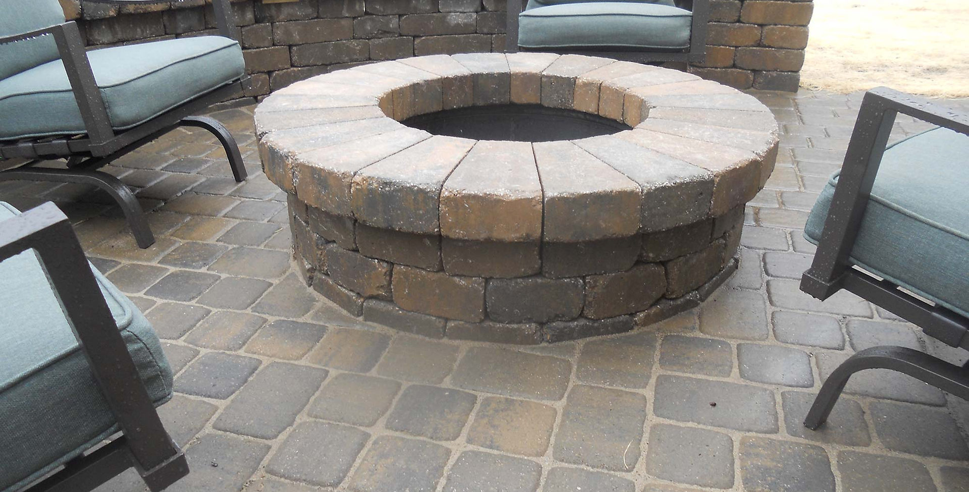 Outlook Hardscape designed circular firepit.