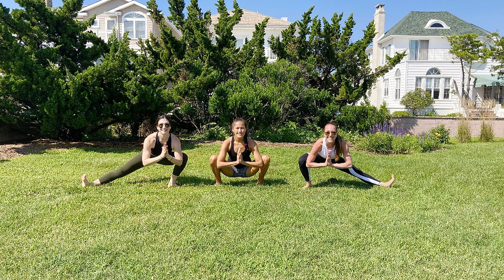 Founders Melissa Green Henkin, Anne Ledyard, and Jacqueline Silva Steuer. / Photograph courtesy of OMM Yoga.