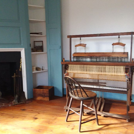 Hand loom and fireplace in our Founders Bedroom.