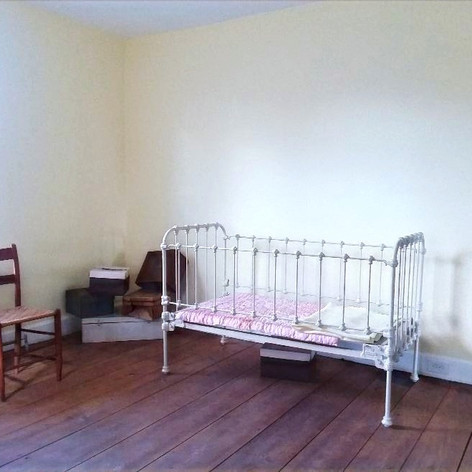 Crib in the Caretakers Bedroom.