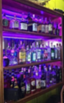 Liquor shelves at Black Pearl Restaurant & Bar, King Lewey's Island Resort, Placencia Belize