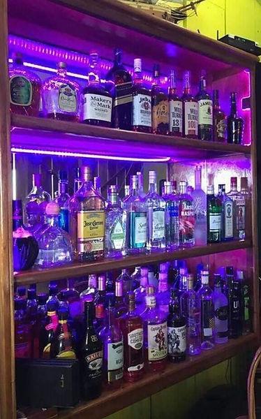Liquor shelves at Black Pearl Restaurant & Bar, King Lewey's Island Resort, Placencia Belize