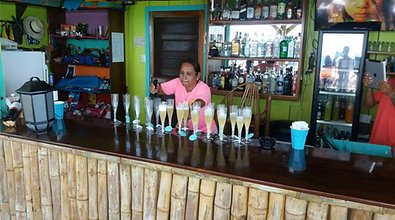 Champagne pouring at the Black Pearl Restaurant & Bar on King Lewey's Island Resort, Placencia Belize