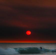 surfing under blood sun