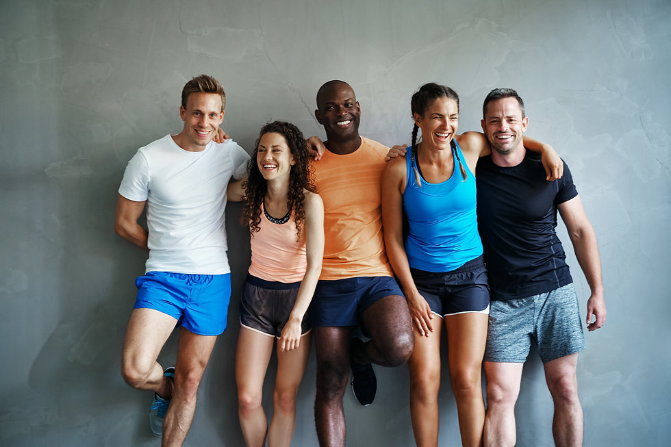 Smiling group of sporty friends in sport