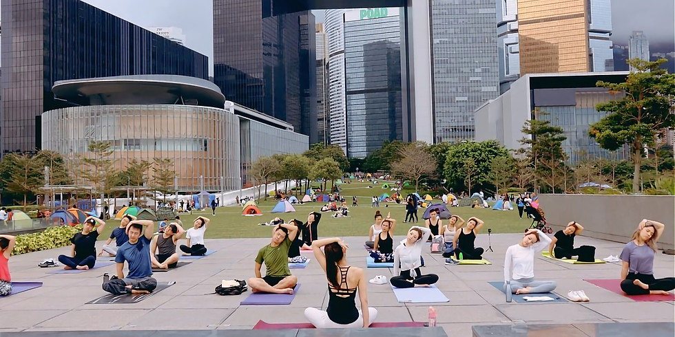 Outdoor sunset charity yoga fundraising for Global warming
