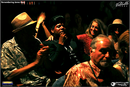 Dedrick Weathersby as James Brown sits i