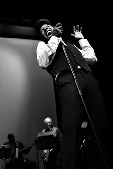 Dedrick Weathersby as James Brown in Rem