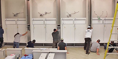 Our installers working as a team to move a huge wall fixture